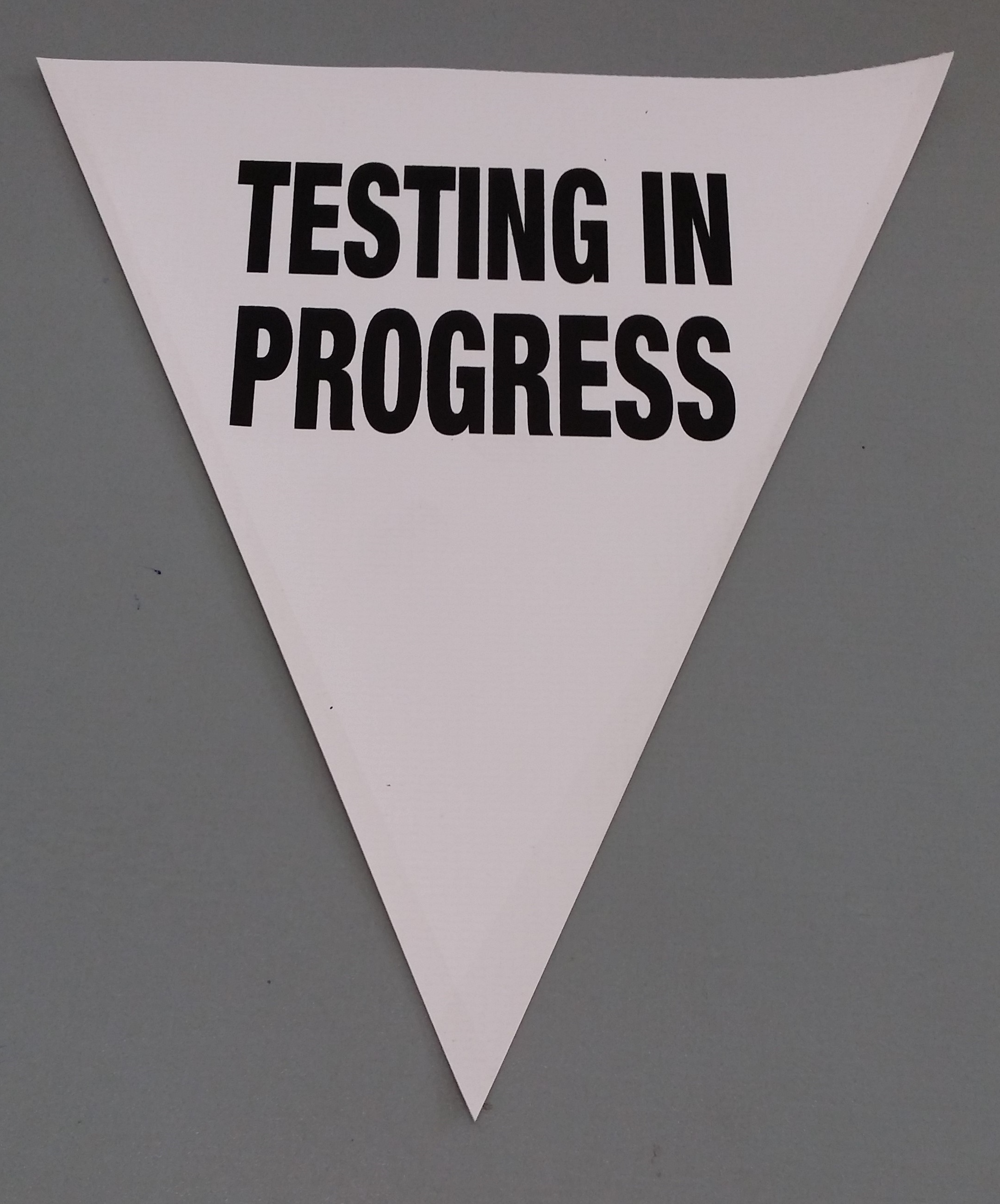 Testing in Progress (white)